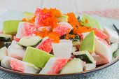 image of masago  - Deconstructed California roll poke made with imitation crab cucumber avocado and capelin roe - JPG
