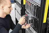 picture of racks  - It engineer or consultant working with installation of a blade server in data rack - JPG