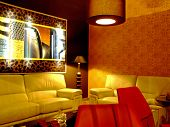 image of futon  - red living room at night with modern furniture - JPG