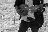 foto of hillbilly  - Thailand traditional musician hillbilly playing country folk music in rice paddy field black and white - JPG