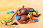 pic of easter candy  - Chocolate Easter eggs with colorful candies on tulle - JPG