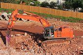 image of breaker  - rock breaker working on a construction site - JPG