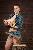 picture of ax  - sexy girl in shirt chopping wood with an ax old - JPG