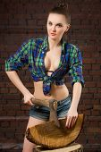 stock photo of ax  - sexy girl in shirt chopping wood with an ax old - JPG