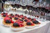 stock photo of buffet  - Festive buffet at the event with desert champagne and wine - JPG