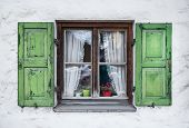 stock photo of bavarian alps  - Authentic window with green wooden shuttters in a small town of Garmisch - JPG