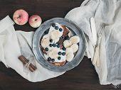 stock photo of maple syrup  - Breakfast set on dark wooden desk - JPG