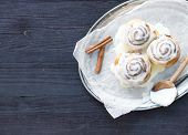 foto of cinnamon  - Cinnamon rolls with cream - JPG