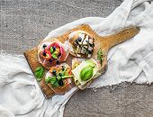 picture of sackcloth  - Brusquetta set on a rustic wooden board over a piece of white linen fabric and a sackcloth background - JPG