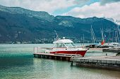 stock photo of coast guard  - Motor boat of a coast guard parked in Annecy France - JPG