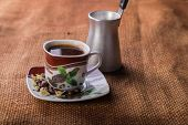 stock photo of brew  - A cup of coffee on the table - JPG