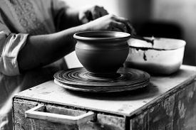 stock photo of pottery  - Pottery Craft Ceramic Clay In Potter Human Hand - JPG