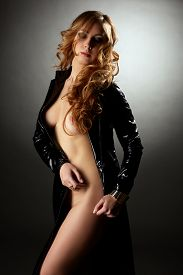 picture of fetish clothes  - Image of curvy hot model posing in black latex coat - JPG