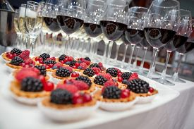 stock photo of banquet  - Festive buffet at the event with desert champagne and wine - JPG