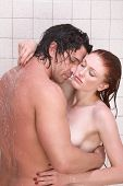 stock photo of aroused  - Loving affectionate nude young heterosexual couple in affectionate sensual kiss after taking shower - JPG