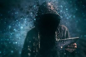 stock photo of hoods  - Pixelated unrecognizable faceless hooded cyber criminal man using digital tablet in cyberspace - JPG