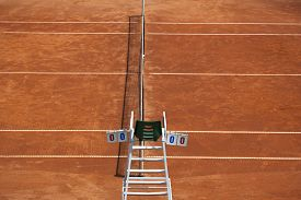 stock photo of umpire  - Umpire chair with scoreboard on a tennis court before the game - JPG