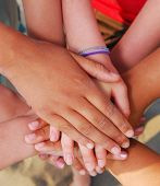 image of joining hands  - Hands of diverse group of teenagers joined in union - JPG