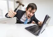 Angry And Crazy Man Is Working With Laptop. He Is Going To Damag poster