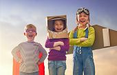 Children in astronaut, pilot and super hero costumes are laughing, playing and dreaming. Portrait of poster