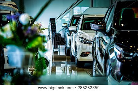 poster of New Luxury Shiny Compact Car Parked In Modern Showroom. Car Dealership Office. Car Retail Shop. Elec