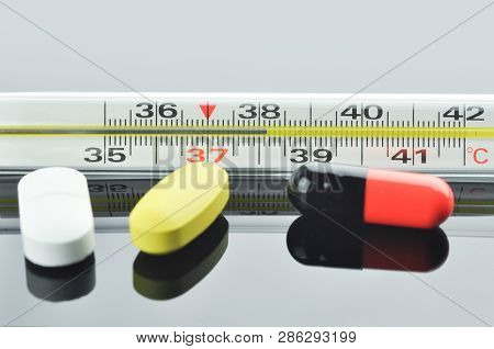Mercury Thermometer And Different Pills