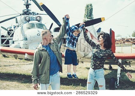 poster of Born To Be Adventurers. Family On Vacation Trip. Couple With Boy Child At Helicopter. Helicopter Tou