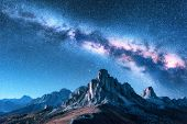 Milky Way Above Mountains At Night In Summer. Landscape With Alpine Mountain Valley, Blue Sky With M poster