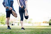 Early Morning Workout, Fitness Couple Stretching Outdoors In Park. Young Man And Woman Exercising To poster