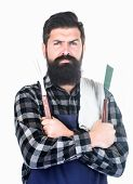 Bearded Hipster Wear Apron For Barbecue. Roasting And Grilling Food. Man Hold Cooking Utensils Barbe poster