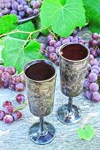 Grape Wine In Silver Glasses. Grapes And Grape Leaves. The Harvest Of Pink Grapes. Still Life With W poster