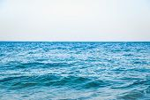 Beautiful Serene Clear Turquoise Sea Ocean Water Surface With Ripples And Low Waves On Seascape Back poster