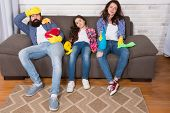 Quality Service. Father And Mother Relax With Little Daughter. Family Clean Home. Happy Family Hold  poster