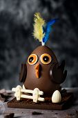 closeup of a funny chocolate chick as a Spanish Mona de Pascua, a traditional confection given by go poster