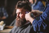 Hands Of Barber With Hair Clipper, Close Up. Hipster Bearded Client Getting Hairstyle. Barber Works  poster