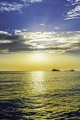 Vertical Shot Of Sunset Over The Sea Horizon - Ocean Horizon With Sunset Sun Behind Clouds - Calm Se poster