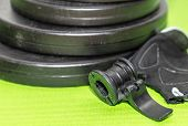 Fitness Expander And Barbell Weight Plates 2 poster