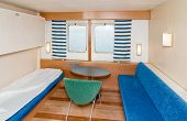 stock photo of cruise ship  - A small cruise ship cabin interior bedroom - JPG