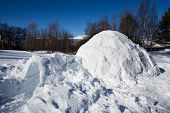 stock photo of igloo  - An igloo in a winter landscape a shelter for winter camping - JPG