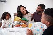 Children Bringing Mother Breakfast In Bed To Celebrate Mothers Day Or Birthday poster