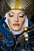 stock photo of muskets  - Beautiful young woman in colorful stylized medieval costume - JPG