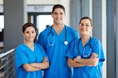 stock photo of scrubs  - group of young hospital workers in scrubs - JPG
