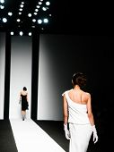 stock photo of female model  - Models on the catwalk during a fashion show - JPG