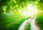 stock photo of sun god  - Lane in meadow and deep blue sky - JPG