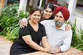 stock photo of indian wedding  - Happy Smiling indian sikh adult people family outdoors - JPG