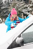 picture of ice-scraper  - Woman cleaning car windshield of snow winter happy young scraper - JPG