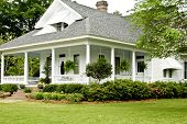 picture of wrap around porch  - Historic White home with wrap around porch.