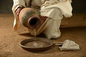 picture of scriptures  - Jesus with a jug of water and a towel on a neutral background - JPG