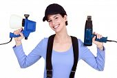 pic of air paint gun  - Woman holding paint sprayer and heat gun - JPG