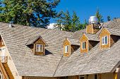 stock photo of shingles  - the roof of the house with nice window - JPG